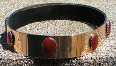 baronial coronet. Red brass with carnelian cabochons.