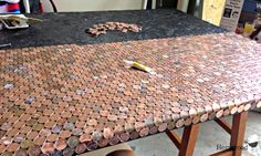 A Penny Desk, countertop, floor...??? These Pennies are awesome for a unique surface!  www.homeroad.net