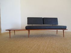 Ah. Mazing. Modern or Mid Century  Miniature Leather  Sofa/ Couch 1:12 scale. $48.00, via Etsy.