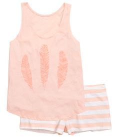 Apricot/Striped. Pyjamas in soft jersey. Vest top with a print motif and short shorts with an elasticated waist.