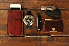 love the leather iphone holder, leather waller, and mini derringer  North American Arms .22 Pocket Revolver