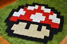 {Super Mario Pixelated Mushroom Blanket} @Elycia Marie Marie Marie Marie crocheted this - it's so cool!
