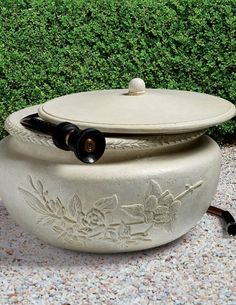 Featuring a textured floral design, this decorative hose pot is constructed to withstand the elements while conveniently concealing up to 100 feet of a garden hose under its lid. It is crafted of a crushed, all-weather stone composite and given a white stone finish.