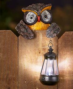 """The Solar Animal Fence Friend is a wonderfully cheerful addition to your yard. This adorable light source features intricate detail and is perfectly molded to fit on top of your fence. It holds a realistic lantern (3"""" dia. x 5-1/2""""H) that soaks up the su"""