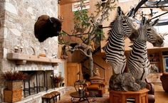 A well-designed trophy room adds up to more than a sum of its mounts Safari Room, Media Room Design, Campaign Furniture, Trophy Rooms, British Colonial, Game Room, Room Inspiration, Animal Print Rug, Hunting Rooms