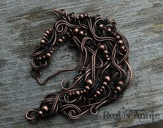 Copper horse with solid copper beads.