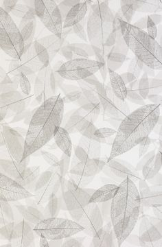 Feuilles Mortes - Leaves are printed in very fine lines of white then offset by light grey shapes to highlight the layered effect.