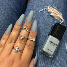 """ Loving this nail polish ""concrete "" by @zaporaofficial the name speaks for itself  ~ I used @sally_hansen big top matte coat ~ Rings @forever21 only…"""