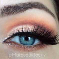 This look blends an assortment of orange and golds for a brightened smokey eye. This is the perfect palette for a stunning autumn look.