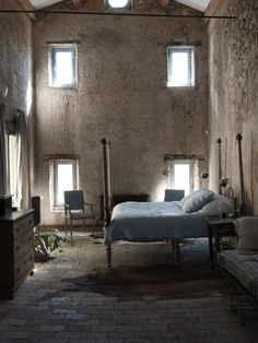 Interesting bedroom design! Love the small windows and the light they give off, and the very minimalist vibe this space has going on. It's simple yet lovely.