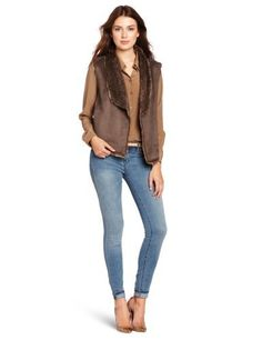 Velvet Women's Rania Faux Sherpa Vest Velvet. $101.49. From urban sherpa group. Dry Clean Only. Holiday 2012 collection. Suede: 100% Polyester; Fur Face: 100% Acrylic; Fur Back: 100% Polyester