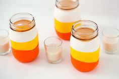 """Balloon Dipped"" Candy Corn Candles - Use balloons and mason jars to make an easy Halloween decorations. Change the colors to match other holidays or personalize a drinking glass for a party Halloween Mason Jars, Halloween Candles, Cheap Halloween, Diy Halloween Decorations, Spooky Halloween, Halloween Pumpkins, Halloween Crafts, Halloween Party, Halloween Ideas"