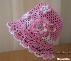 Pink hat with diagrams