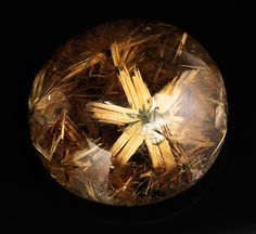 Six-pointed rutile stars formed inside smoky quartz crystals