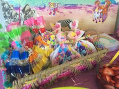 Lisa frank birthday party rainbows hot pink first birthday baby girl cake unicorns goody bags loot bags clothes pin