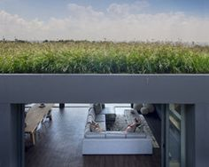 We can't resist a grass-roof house... especially one in Africa