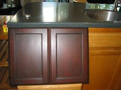 Painting cabinets: an expert painter gives tips about how to coloring cabinets. Helpful tips for remodelers looking to skillfully fresh paint kitchen cupboards. Oak Kitchen Remodel, Oak Kitchen Cabinets, Brown Cabinets, Kitchen Cabinet Colors, Kitchen Redo, Kitchen Colors, Colored Cabinets, Kitchen Tips, Kitchen Ideas