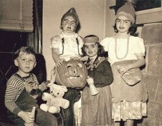 Russell Froelich Jr. and friends dressed in Halloween costumes. (1945)