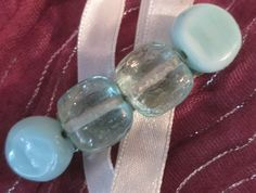 """medium silver hair clip; light green and white glass beads 2""""by 1/2"""" product$H016  $5.00"""