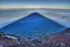 "Photographer Captures Perfect Shadow of Mt. Fuji at Sunrise: ""While climbing Mt. Fuji in 2012, photographer Kris J B managed to capture this crystal clear shot of the mountain's shadow at sunrise. The 12,388 ft. Fuji is notoriously shy and is often obscured by low hanging clouds or fog. This was the photographer's 4th attempt to climb the mountain, an ascent in 2011 left him with a tantalizing, but ultimately unsatisfactory photograph of the mountain's perfectly triangular shadow..."" #photo"