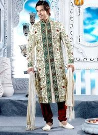 Green and white brocade sherwani . Sherwanis are the most preferred ones and comes with varied embroidery styles stitched on it in gold or silver threads