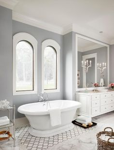 It Sherwin Williams Mindful Gray, one of our go to colors! Trim is Westhighland White by by Sherwin Williams