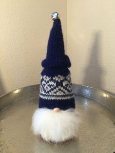 Gunnar the Swedish Tomte is perfect for gift giving and Holiday decorating. He has been lovingly created from a thick colorful fair isle repurposed authentic Nordstrikk brand pure new wool sweater made in Norway. This richly colored sweater is navy blue with ivory accents in a fair isle pattern, and has been felted and reimagined into the warm handsome hat that Gunnar is wearing. It has been hand stitched and sewn by me with a needle and embroidery floss. His full beard is made from…