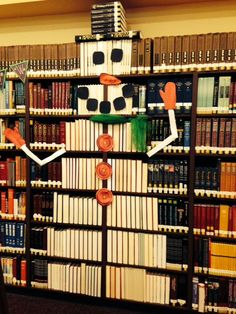 Shelf Art: Turn books around to create a snowman ... save those matching black books for the hat ... and decorate!