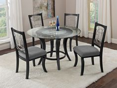 Pasadena Dining Room Collection | Furniture.com. This stunning dinette features a round table with a 48-inch diameter and black wood finish, a decorative circle-and-loop metal base with faux marble inset, and a tempered beveled glass top.