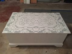 Wood table painted white, then lace table cloth laid on top and spray painted, then lace removed.