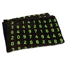 """Pi Blanket. Its 45"""" x 64"""" expanse features the first 413 digits of Pi in green text against a black background. (Think Geek)"""