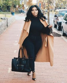 Love this all black ensemble paired with a camel coat.