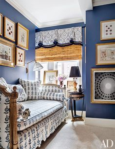 Painted a Benjamin Moore blue, the guest room features a Louis XVI daybed upholstered in a Les Indiennes fabric.