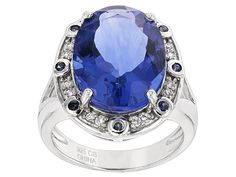 11.00ct Oval Color Change Blue Fluorite With .13ctw Blue Sapphire And .13ctw Zircon Silver Ring
