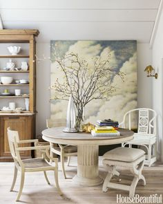 An original cloud painting by Sonoma artist Wade Hoefer accentuates the ethereal character of the Montpellier pedestal dining table.