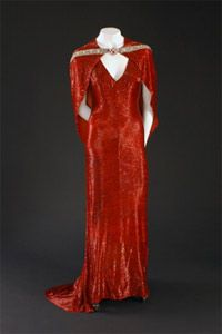 """Red dress worn by Joan Crawford in """"The Bride Wore Red"""", 1937. Fashion Institute of Technology - American Beauty: Aesthetics and Innovation in Fashion"""