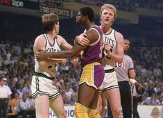 Larry Bird intervenes as an angry Magic Johnson has words with Danny Ainge during Game 2 of the 1985 NBA Finals. The Lakers would wind up winning the game in overtime on their way to an NBA. Magic Johnson, Larry Bird, Lakers Vs Celtics, Boston Celtics, I Love Basketball, Basketball Legends, Basketball History, Basketball Photos, Sports Photos