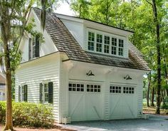 I really like the look of this garage with the doors & big shed dormer for bonus room above.