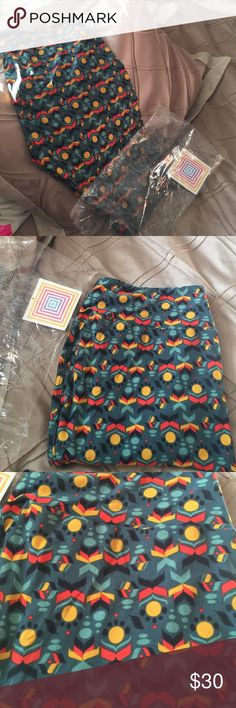 Tc LuLaRoe leggings Won in a roulette! Decided not to keep them! Beautiful for fall/winter! New in package! Took out for picture! LuLaRoe Pants Leggings