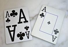 Something as simple as large number cards with bold black lettering - like the one on the left - will keep you playing card games with friends and family.