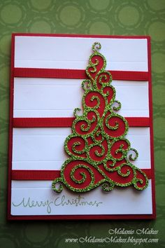 handmade Christmas card ... luv the use of glitter paper for the swirly tree die cut ...like the bands of ribbon ....