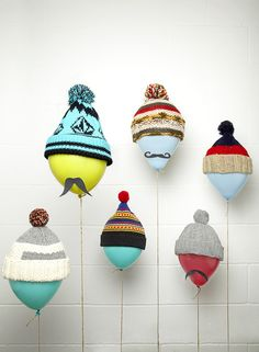 Adorable way to show off winter hats.