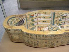 https://flic.kr/p/3jZZFz | Box of an Anthropoid Coffin | Box of an Anthropoid Coffin Egyptian, Dynasty 20-21 (ca. 1150-945 BC). . The figures on the interior of this finely decorated wooden coffin are painted in a detailed, colorful style very like contemporary painted tombs.  In the center stands the deified King Amenhotep I in the guise of the mummiform Osiris attended by a priest in a panther skin, A human-headed Ba-bird (presumably the soul of the coffin's onwer), and a crouching…