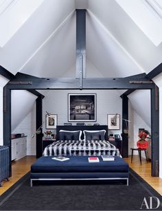 In the master bedroom of this Veere Grenney–designed London townhouse, works by Picasso flank a photograph of Beijing's Temple Hotel. Read on for more beautiful vaulted ceilings.