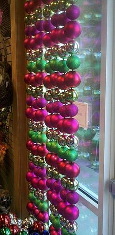 Christmas window treatment - get cheap ornaments at the dollar store, hang on…