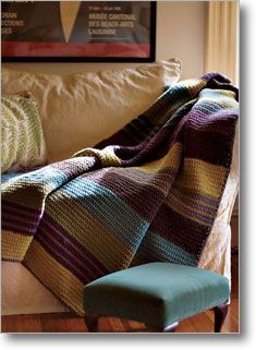 Simple afghan in single crochet -- but what a great showcase for playing with color!  Would probably work well with different yarn textures, and would be fun to pair with a quilt sewn using the same striping pattern and complementary colors.  By Leigh Radford at Interweave.