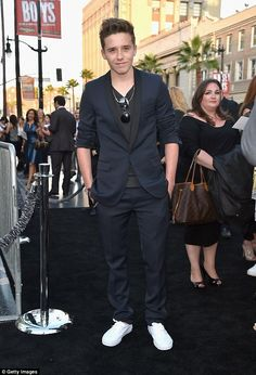 Growing up fast: Brooklyn, the eldest of David and Victoria's four children, is loving the limelight and is often seen competiting in a light-hearted manner with his famous father