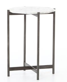 A geometric hexagon in white marble tops this mid-century chic side table, complete with a black metal frame that's so on-trend.