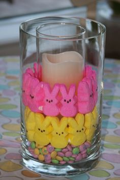 Easter Peeps decoration - Arrange a small cylinder glass (for the candle) inside a larger one. Layer different candies to create this Easter treat. After Easter replace the candies with different botanicals, marbles and other decorative filler. Spring Crafts, Holiday Crafts, Holiday Fun, Hoppy Easter, Easter Eggs, Easter Bunny, Easter Food, Easter Stuff, Diy Ostern
