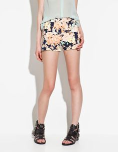 Printed Floral Shorts- I would totally wear those.